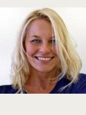 Dent Elite - Dr. Nora Fazekas, Implant Specialist