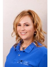 Dr Rothy Zsuzsanna - Orthodontist at Dentors Marina Gums and Smile Clinic
