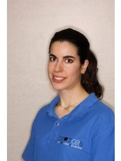 Dr Andrea - Dentist at Dentors Marina Gums and Smile Clinic