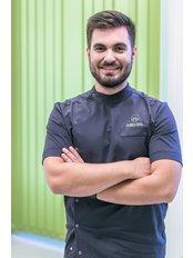 Dr. Tamás Rádi - Zahnarzt - Evergreen Dental