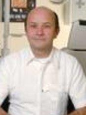Dr. Frank Kannmann -  - SancoDental