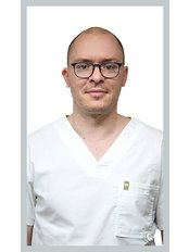 Dr Adorján Szakál - Dentist at Forest & Ray Dental Budapest