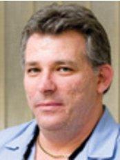 Dr. Peter Magos - Zahnarzt - Kreativ Dental