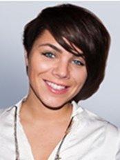Dr. Adriána Osze -  - Marident-Csalogány