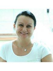 Ms Juhász Tímea - Dentist at Qualy-Dent
