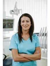 Dr Monika Savanya - Dentist at Save on Dental Care - Budapest