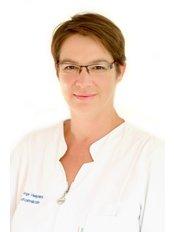 Dr Kinga Visegrády - Dentist at Denis and Focus Zahnklinik