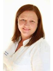 Dr Mónika Völgyi - Dentist at Denis and Focus Zahnklinik