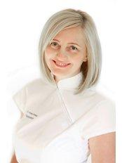 Ms Andrea Chinorányi - Dentist at Denis and Focus Zahnklinik