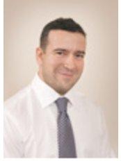 Peter Bella - Oral Surgeon at DentAll 4 One