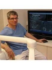 Dr Tamás Gerencsér - Dentist at DHS (Dental Health Service)