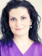 Dr Vida Melinda Augustine - Doctor at Dentoplant