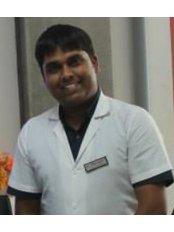 Dr Hiren Chokshi - Dentist at Modi Mulstispecialty Dental Clinic