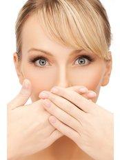 Bad Breath Treatment - AMS Multispeciality Dental Clinic
