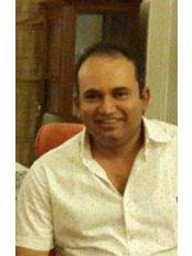 Dr Sandeep Thimmiah - Dentist at Vignesh Dental Speciality Center