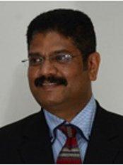 Dr Rajesh Kumar MDS - Oral Surgeon at Thangams Dental Implant Center