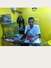 Goa Dental Clinic - Candolim - Dr Toshepu Aomi Dental Surgeon and Implantologist