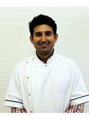 Dr Kaushal Sharma - Dentist at Dr. Sachin Mittal's Advanced Dentistry