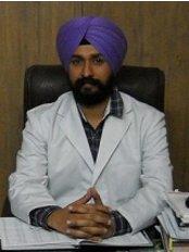 Dhingra Dental Care & Implant Centre - Dr Mandeep Singh Dhingra