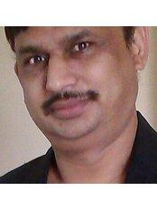 Dr Baldev raj Virdi - Dentist at Rajpal standard care dental clinic