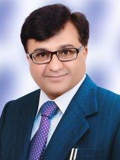 Dr. Bharat Katarmal - A Family Dentist - Dr Bharat Katarmal