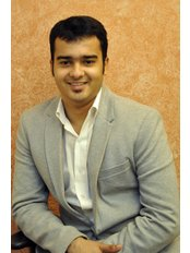 Dr.Abhishek Modi - Principal Dentist at Dr.Teeth Implant and Aesthetic Centre