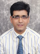 Dr Chopra's Implant & Orthodontic Clinic - Dr Ashish Chopra -orthodontist