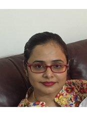Dr DHIRJA GOEL - Dentist at Dentessence Dental Care and Implant Centre