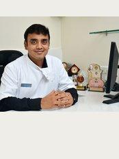 Swastik Dental Care - dr. parashant Gadiya