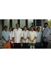Adarsh Dental Care and Implant Center Branch - 1st Floor, Bhula Building Opp. Tribhovandas Govanbhai, Jariwala, Lalgate, Surat, 395003,  0