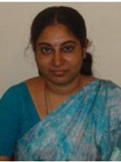 Dr Rajakumari Kenkre -  at Arun's Dental Art