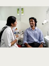 Dr. Smilez Dental Clinic Anna Nagar - Doctor at Dr Smilez consulting a patient