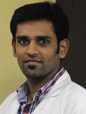 Dr.Bejoy Mony - Doctor at Srivari Dental Clinic