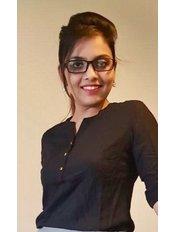 Dr Megha vyas - Surgeon at Esthetica Maxillofacial & Dental Hospital