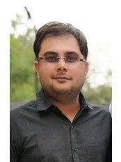 Dr Dhaval Trivedi - Dentist at Esthetica Maxillofacial & Dental Hospital