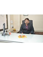 Dr Praful  Furiya - Dentist at furiyas dental studio