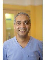 Dr Akram Elhadi - Dentist at Tobin Healthcare Centre Dental Ltd.