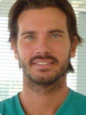 Dr Enrico Guggia - Dentist at Dentiamo - Cliniche Odontoiatriche - Udine