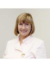 Dr Inara Karopva - Dentist at Royal Dent - Swiss American Corporation