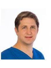 Dainius Razukevicius - Dentist at UAB