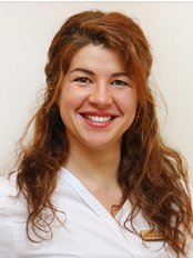 Eve Totiliene - Doctor at Peace Dental Clinic