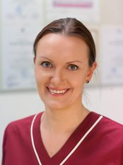 Dr Jurgita Raulynaitiene-Pundzaite - Dentist at Denticija Dental Clinic