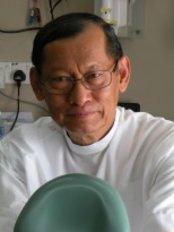 Dr Dzulkhaini Haji Husain - Oral Surgeon at Dzul Orthodontic and Dental Surgery - Damansara Utama