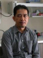 Dr Mohd Kamal Bin Shakimon - Oral Surgeon at Dzul Orthodontic and Dental Surgery - Damansara Utama