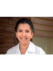 Dr Resha Malik - Dentist at Living Well - Star Hill Gallery