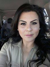 Dr. Cecilia Marin - Oral Surgeon at Dental Clinic Dr. Herminia Marin Cota
