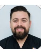 Dr Sigi  Inzunza - Dentist at Supreme Dental Clinic