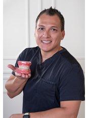 Dr Homero Rivera -  at THE SMILE SHOPPE