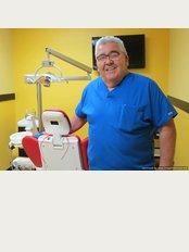 Dental World - Dr.Carlos Fuentes