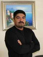 Naty's Dental Clinic (Implants, Sedation, Dental Restorations) - Dr. Manuel Bazán